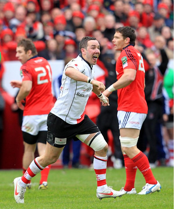 Ulster's Darren Cave (C) celebrates at the final whistle as they defeat Munster 22-16 during the European Cup rugby union quarter final match between Munster and Ulster at the Thomond Park in Limerick