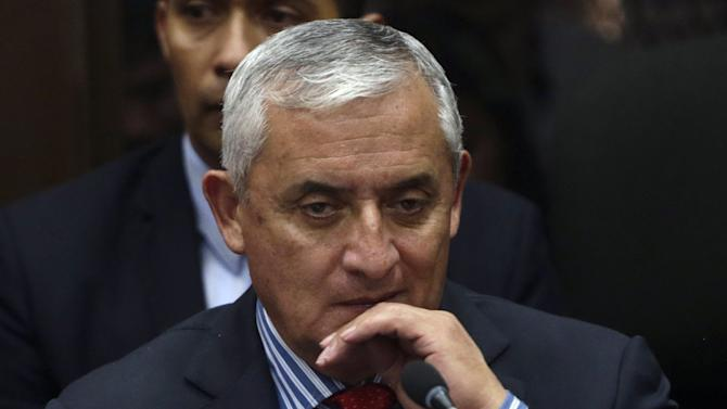 Guatemala's President Otto Perez Molina attends a hearing at the Supreme Court of Justice in Guatemala City