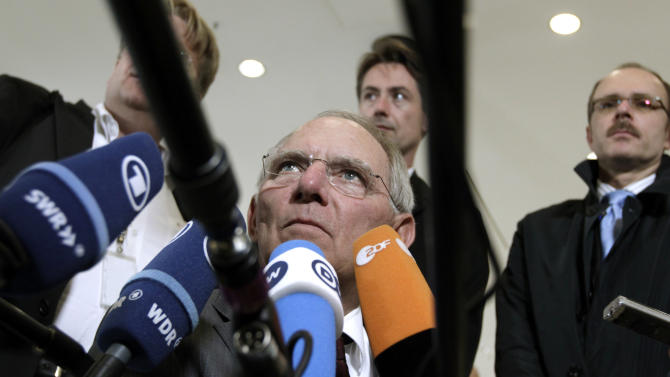 German Finance Minister Wolfgang Schaeuble speaks with the media prior to a meeting of eurozone finance ministers in Luxembourg on Thursday, June 21, 2012. As the cracks in the euro currency seem to grow even wider, finance ministers from the 17 countries that use the currency brainstorm Thursday on how to stabilize it. (AP Photo/Virginia Mayo)