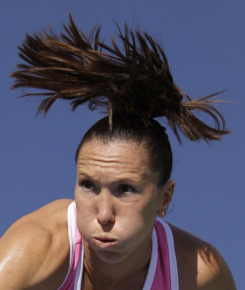 Serbia's Jelena Jankovic serves to Spain's Lara Arruabarrena-Vecino in the second round of play at the 2012 US Open tennis tournament,  Thursday, Aug. 30, 2012, in New York. (AP Photo/Kathy Willens)