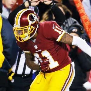 Washington Redskins quarterback Robert Griffin III hits wide receiver DeSean Jackson for 55 yards