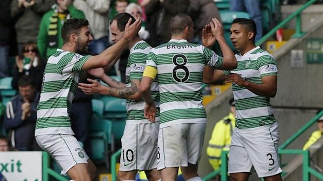 Anthony Stokes, second left, celebrates with his team-mates