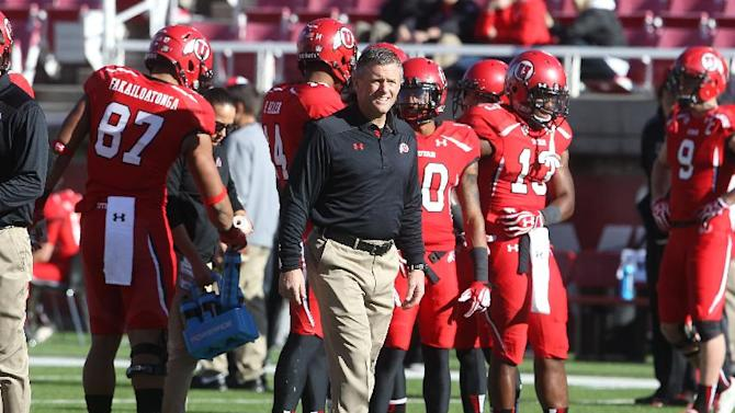 Utah head coach Kyle Whittingham looks on in the first half during an NCAA college football game against Colorado Saturday, Nov. 30, 2013, in Salt Lake City. Utah won 24-17