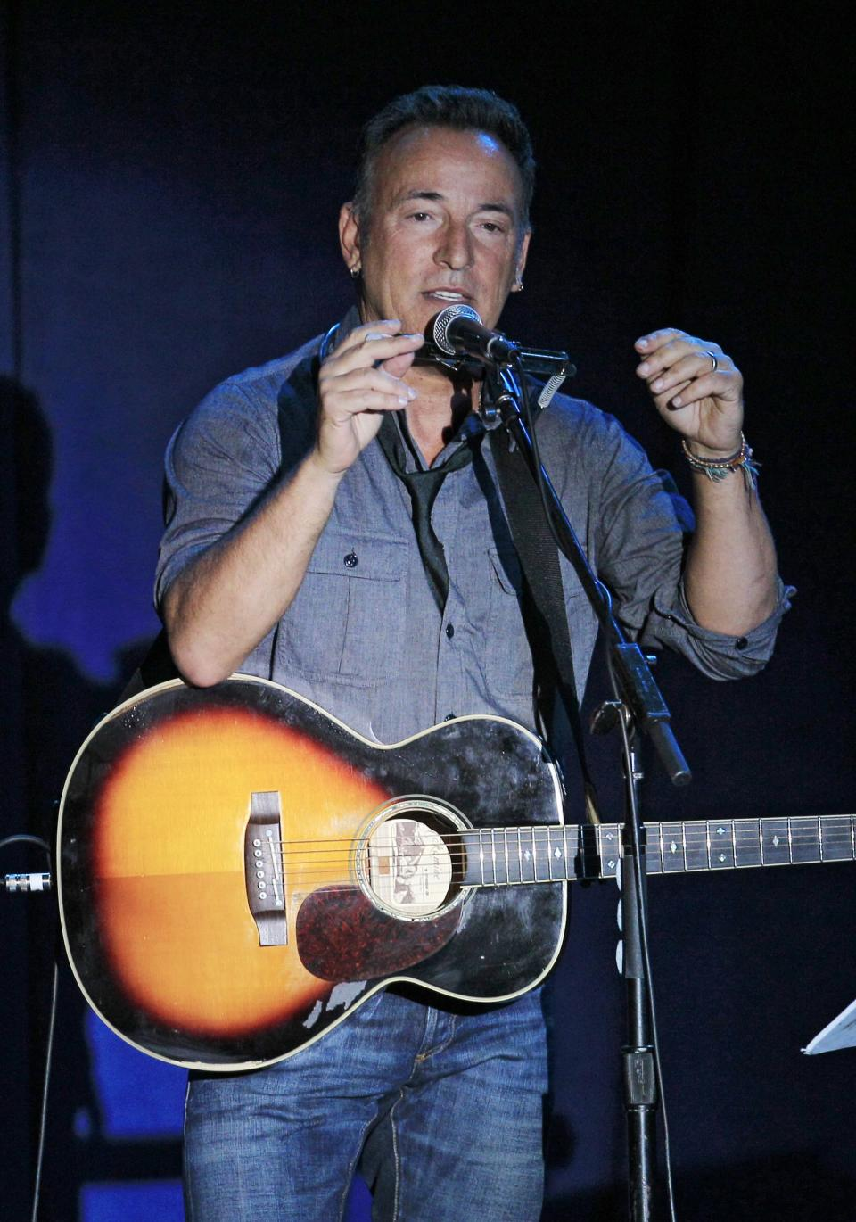 Singer-songwriter Bruce Springsteen performs at a campaign event for President Barack Obama, Thursday, Oct. 18, 2012, in Parma, Ohio. (AP Photo/Tony Dejak)