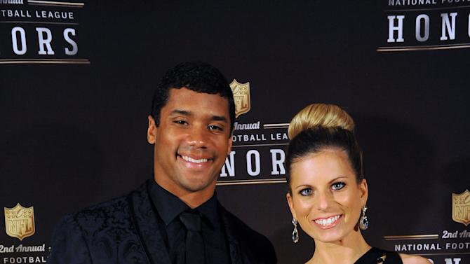 IMAGE DISTRIBUTED FOR PEPSI - Seattle Seahawks Quarterback Russell Wilson and his wife Ashton are seen after he wins fan-selected  Pepsi MAX Rookie of the Year Award at the 2nd Annual NFL Honors on Saturday, Feb. 2, 2013 , in New Orleans.(Photo by Cheryl Gerber/Invision for Pepsi/AP Images)