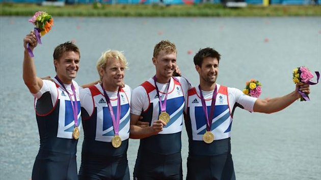 Great Britain&#39;s Pete Reed, Andrew Triggs Hodge, Alex Gregory and Tom James pose on the podium after receiving their gold medal