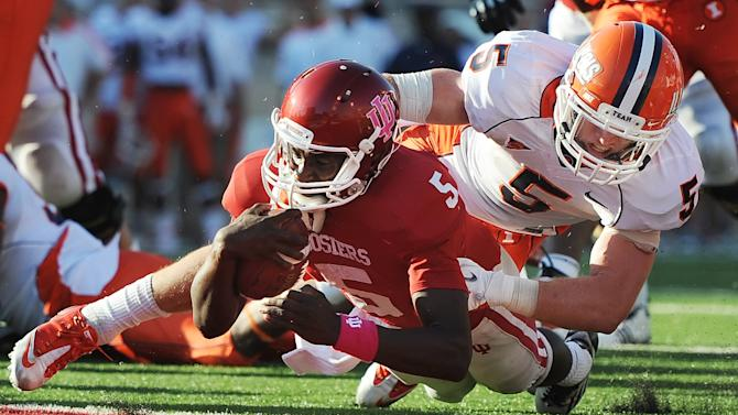Indiana quarterback Tre Roberson (5) runs the ball in for a touchdown as Illinois defensive back Steve Hull (5) goes in for the tackle during an NCAA college football game at Memorial Stadium in Bloomington, Ind., Saturday, Oct. 8, 2011. Illinois won 41-20. (AP Photo/The Herald-Times, Chris Howell)