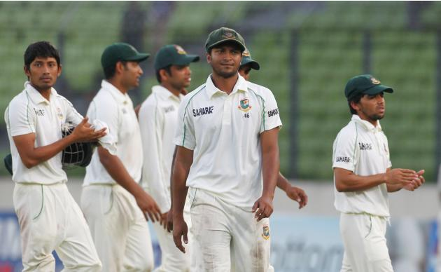 Bangladesh's Al Hasan comes off the field with other players after the end of the third day of second test cricket match of the series in Dhaka.