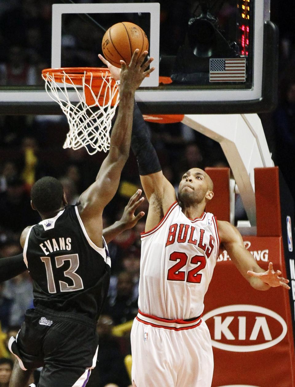 Chicago Bulls power forward Taj Gibson (22) challenges a shot by Sacramento Kings point guard Tyreke Evans (13) during the second half of an NBA basketball game, Wednesday, Oct. 31, 2012, in Chicago. The Bulls won 93-87. (AP Photo/Charles Rex Arbogast)