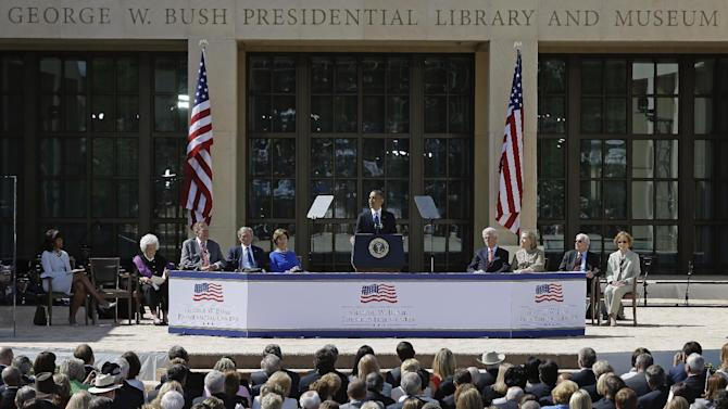 President Barack Obama speaks during the dedication of the George W. Bush Presidential Center, Thursday, April 25, 2013, in Dallas. Seated, from left are, first lady Michelle Obama, former first lady Barbara Bush, former President George H.W. Bush, former President George W. Bush, former first lady Laura Bush, former Bill Clinton, former first lady and former Secretary of State Hillary Rodham Clinton, former President Jimmy Carter, and former first lady Rosalynn Carter.   (AP Photo/David J. Phillip)