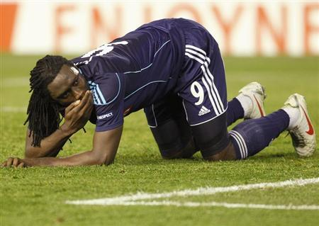 Stoke City's Jones lies on pitch after a fall during their Europa League soccer match against Valencia