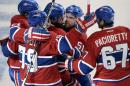 Montreal Canadiens defenseman P.K. Subban, center, celebrates with teammates Andrei Markov (79), Max Pacioretty (67), David Desharnais (51) and Devante Smith-Pelly (21) after scoring the second goal against the Ottawa Senators during the second period in Game 2 of an NHL hockey first-round playoff series, Friday, April 17, 2015 in Montreal. (Ryan Remiorz/The Canadian Press via AP) MANDATORY CREDIT