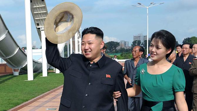 "FILE - In this July 25, 2012 file photo released by the Korean Central News Agency and distributed in Tokyo by the Korea News Service, North Korean leader Kim Jong Un, accompanied by his wife Ri Sol Ju, waves to the crowd as they inspect the Rungna People's Pleasure Ground in Pyongyang, North Korea. The online version of China's Communist Party newspaper has hailed a report by The Onion naming Kim as the ""Sexiest Man Alive"" - not realizing it is satire. The People's Daily on Tuesday, Nov. 27, 2012 ran a 55-page photo spread on its website in a tribute to the round-faced leader, under the headline ""North Korea's top leader named The Onion's Sexiest Man Alive for 2012."" (AP Photo/Korean Central News Agency via Korea News Service, File)"