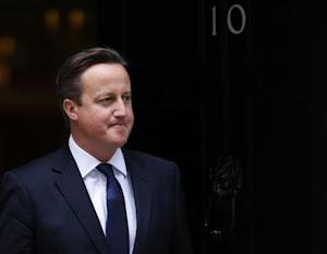 Britain's Prime Minister, David Cameron waits to greet the Prime Minister of New Zealand, John Key, outside 10 Downing Street in central London