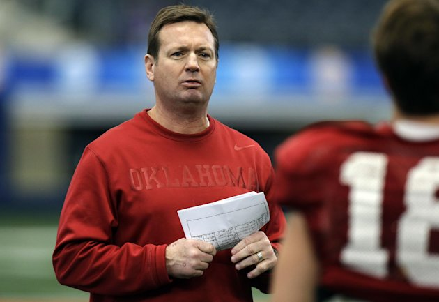 Oklahoma head coach Bob Stoops watches practice for the Cotton Bowl NCAA college football game at Cowboys Stadium, Sunday, Dec. 30, 2012, in Arlington, Texas. Oklahoma is scheduled to play Texas A&amp;M o