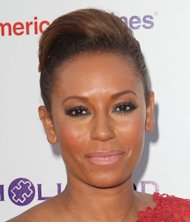 Melanie Brown lands restraining order against paparazzo