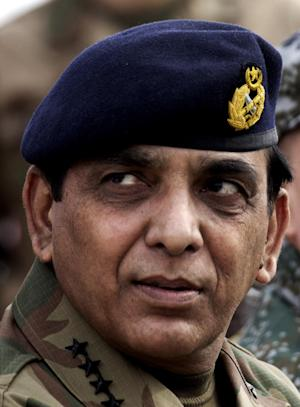 FILE - In this Thursday, Nov. 24, 2011 file photo, Pakistan army Chief Gen. Ashfaq Parvez Kayani listens to a reporter in Jhelum, Pakistan. Pakistan's powerful army chief has issued a rare public statement warning against efforts to undermine the country's military. (AP Photo/B.K. Bangash, File)