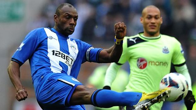 Wigan Athletic's Barbadian defender Emmerson Boyce (L) clears the ball away from Newcastle United's French forward Yoan Gouffran (AFP)