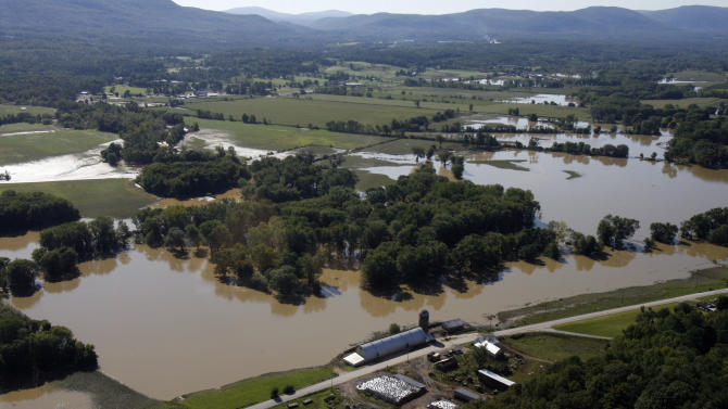 FILE-In this Aug. 30, 2011, file photo, farmer's fields are flooded from Tropical Storm Irene in this aerial view on Tuesday, Aug. 30, 2011 in Rutland, Vt. A year after Hurricane Irene tore through farms from North Carolina to Vermont, some farmers are still grappling with the aftermath. (AP Photo/Toby Talbot)
