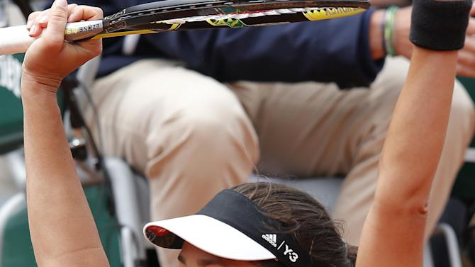 Serbia's Ana Ivanovic celebrates winning her fourth round match of the French Open tennis tournament in three sets 7-5, 3-6, 6-1, against Russia's Ekaterina Makarova at the Roland Garros stadium, in Paris, France, Sunday, May 31, 2015. (AP Photo/Michel Euler)