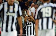 Juventus&#39; forward Fabio Quaglierella (C) celebrates after scoring his second goal during their Serie A match against Chievo Verona at the Stadio delle Alpi in Turin. Juventus won 2-0