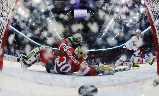 Team USA's Barber scores a goal on Czech Republic's goalie Machovsky during their quarter-final game at the 2013 IIHF U20 World Junior Hockey Championship in Ufa