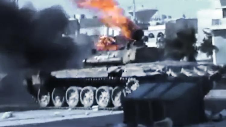 In this image made from amateur video released by the Ugarit News and accessed Monday, July 23, 2012, a Syrian military tank catches on fire during clashes with Syrian government troops in Aleppo, Syria. The Syrian regime acknowledged for the first time Monday that it possessed stockpiles of chemical and biological weapons and said it will only use them in case of a foreign attack and never internally against its own citizens. Aleppo, Syria's biggest city with about 3 million residents, has been the focus of rebel assaults by a newly formed alliance of opposition forces called the Brigade of Unification. (AP Photo/Ugarit News via AP video) TV OUT, THE ASSOCIATED PRESS CANNOT INDEPENDENTLY VERIFY THE CONTENT, DATE, LOCATION OR AUTHENTICITY OF THIS MATERIAL