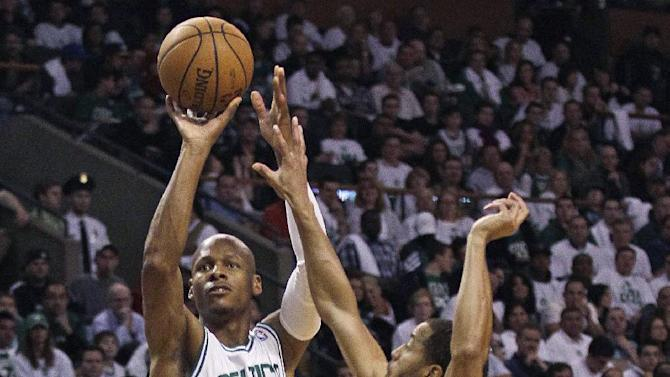 Boston Celtics guard Ray Allen (20) shoots over Atlanta Hawks guard Jannero Pargo (7) during the first quarter of Game 3 of an NBA first-round playoff basketball series, Friday, May 4, 2012, in Boston. Allen has been sidelined with bone spurs in his right ankle since April 10. (AP Photo/Charles Krupa)