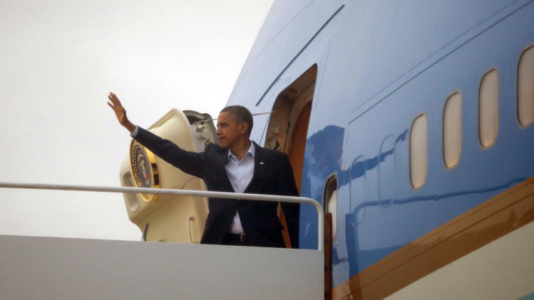 President Barack Obama waves as he boards Air Force One before his departure from Andrews Air Force Base, Md., Sunday, Oct., 28, 2012. (AP Photo/Pablo Martinez Monsivais)
