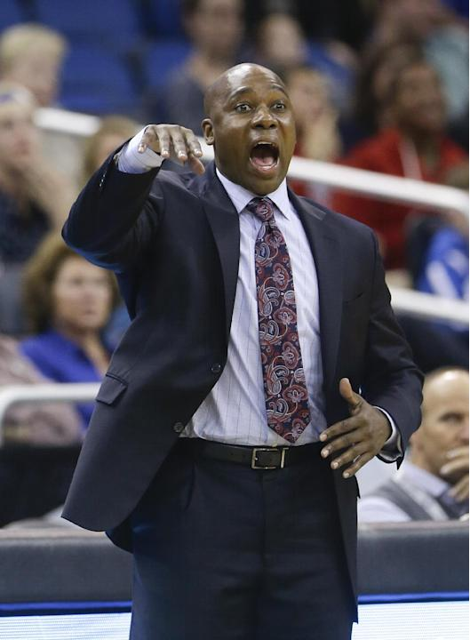 Orlando Magic head coach Jacque Vaughn directs his team against the Utah Jazz during the second half of an NBA basketball game in Orlando, Fla., Wednesday, Dec. 18, 2013. Utah won the game 86-82