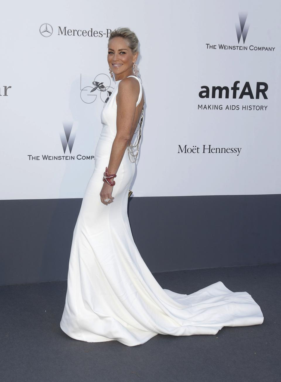 Actress Sharon Stone arrives at amfAR Cinema Against AIDS benefit at the Hotel du Cap-Eden-Roc, during the 66th international film festival, in Cap d'Antibes, southern France, Thursday, May 23, 2013. (Photo by Todd Williamson/Invision/AP)