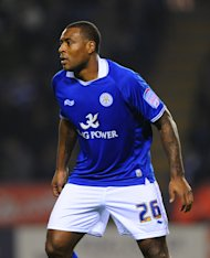 Wes Morgan scored the first goal as Leicester beat Peterborough on the opening day