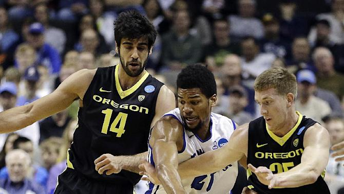 Oregon's Arsalan Kazemi (14), Saint Louis forward Dwayne Evans (21), and Oregon forward E.J. Singler (25) chase a loose ball during the first half of a third-round game in the NCAA college basketball tournament, Saturday, March 23, 2013, in San Jose, Calif. (AP Photo/Ben Margot)