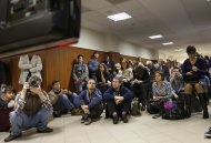 Media watch a TV screen in a hall outside a court room of the Moscow City Court where three members of the punk band Pussy Riot are set to make their case before a Russian appeals court that they should not be imprisoned, in Moscow, Wednesday. Oct. 10, 2012. Their impromptu performance inside Moscow&#39;s main cathedral in February came shortly before Putin was elected to a third term. The three women were convicted in August of hooliganism motivated by religious hatred and sentenced to two years in prison. (AP Photo/Sergey Ponomarev)