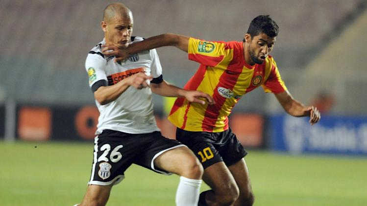 Esperance of Tunis Striker Oussama Darragi (#10) challenges Algeria's ES Setif defender Mohamed Lagraa (#26) during their CAF Champions League football match on May 17, 2014 at the Olympic Stadium in the Tunisian port city of Rades