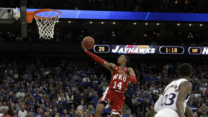 Western Kentucky guard Jamal Crook goes in for a shot during the first half of a second-round game against Kansas in the NCAA men's college basketball tournament Friday, March 22, 2013, in Kansas City, Mo. (AP Photo/Charlie Riedel)