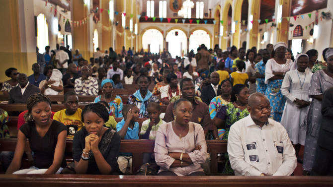 Churchgoers attend a New Year's Day morning mass at the Notre Dame Cathedral of the Immaculate Conception in Bangui, Central African Republic, Tuesday, Jan. 1, 2013. President Francois Bozize's government is coming under growing threat as rebels vowing to overthrow him rejected appeals from the African Union to hold their advance and try to form a coalition government. (AP Photo/Ben Curtis)