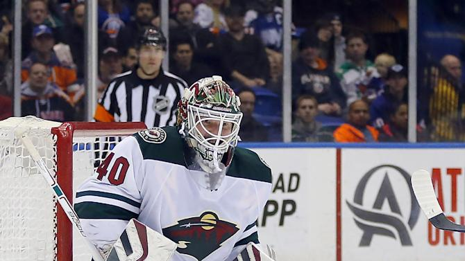 Parise leads Wild past Isles in SO for 10th straight on road