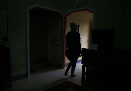 A transgender person walks at her office in Banda Aceh