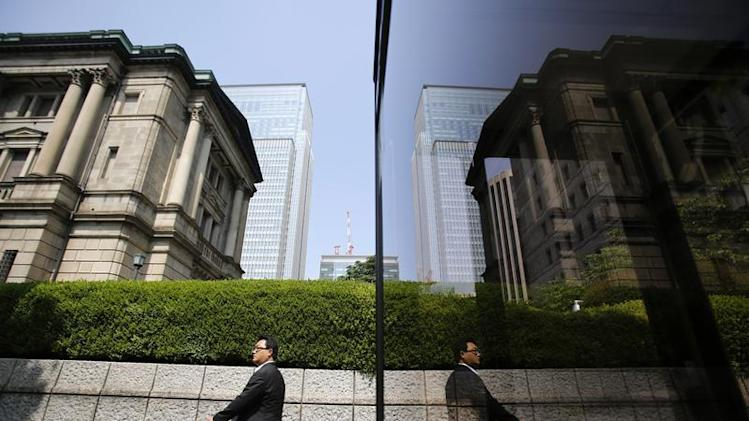 Pedestrian walks past the Bank of Japan building in Tokyo