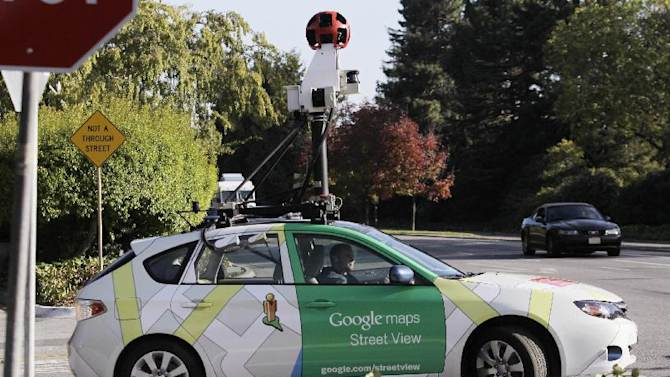 "FILE - In this Oct. 27, 2010 file photo, an employee drives a Google Maps Street View vehicle around Palo Alto, Calif. Internet giant Google's Street View project has raised privacy concerns in several countries. Attorneys suing Google for enabling its camera-carrying vehicles to collect emails and Internet passwords while photographing neighborhoods for the search giant's popular ""Street View"" maps look forward to resuming their case now that a U.S. appeals court has ruled in their favor. The U.S. Court of Appeals in San Francisco said Tuesday that Google went far beyond listening to accessible radio communication when they drew information from inside people's homes. (AP Photo/Paul Sakuma, File)"