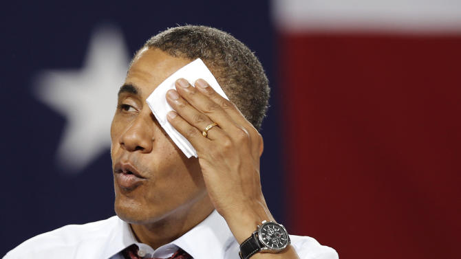 President Barack Obama wipes sweat from his forehead while speaking to supporters during a campaign stop in Windham, N.H., Saturday, Aug. 18, 2012. (AP Photo/Winslow Townson)