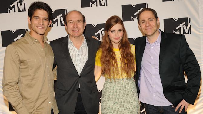 "IMAGE DISTRIBUTED FOR MTV - Tyler Posey from ""Teen Wolf"", Philippe Dauman President and CEO Viacom, Holland Roden from ""Teen Wolf"", Stephen Friedman President of MTV arriving at the 2013 MTV Upfront, on Thursday, April 25, 2013 at the Beacon Theater in New York. (Photo by Scott Gries/Invision/AP Images)"