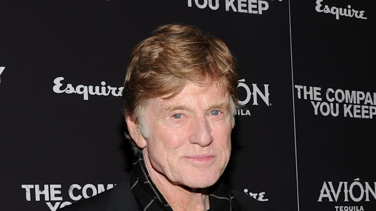 "FILE - This April 1, 2013 file photo shows director and actor Robert Redford at the premiere of ""The Company You Keep"" at The Museum of Modern Art in New York. CNN is planning an unscripted series about Chicago that will be executive-produced by Robert Redford. The eight-part series, ""Chicagoland,"" will premiere in 2014.  (Photo by Evan Agostini/Invision/AP, file)"
