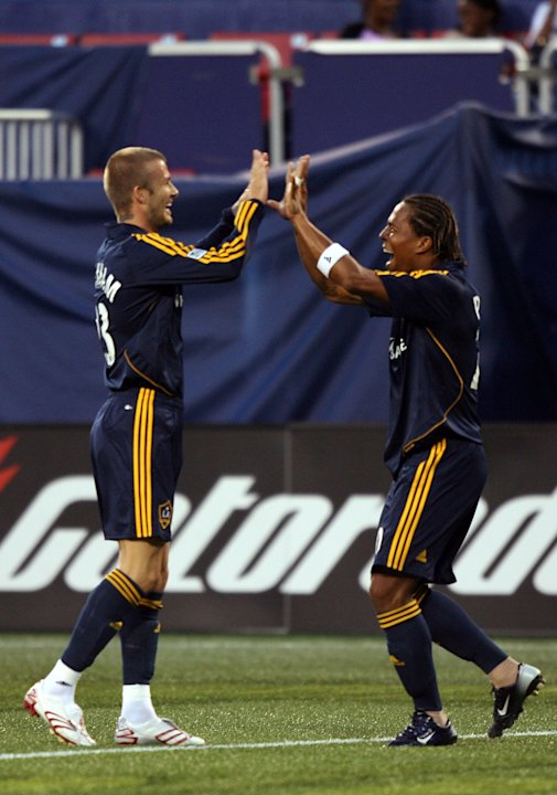 EAST RUTHERFORD, NJ - AUGUST 18: David Beckham #23 of the Los Angeles Galaxy celebrates with Carlos Pavon #20 after their first goal against the New York Red Bulls at Giants Stadium on August 18, 2007