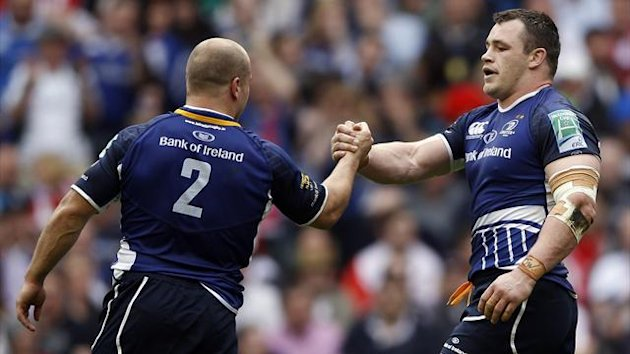 Leinster's Cian Healy (R) celebrates with teammate Richardt Strauss after scoring a try against Ulster during their Heineken Cup final rugby match at Twickenham Stadium
