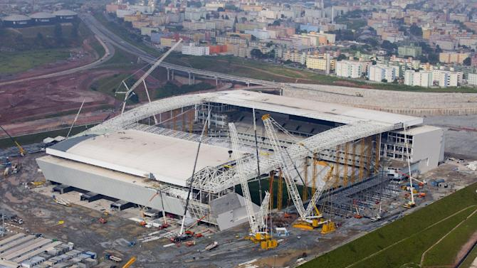 FILE - This March 2014 file photo released by Portal da Copa, shows an aerial view of the Itaquerao stadium in Sao Paulo, Brazil. It's all coming down to the final 30 days. Brazil had seven years to get ready for the World Cup, but it enters the final month of preparations with a lot yet to be done. (AP Photo/Portal da Copa, Mauricio Simonetti, File)