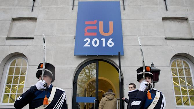 A cameraman enters the Maritime Museum for a tour de table ahead of an informal meeting of EU defense ministers in Amsterdam, Netherlands, Friday, Feb. 5, 2016. (AP Photo/Peter Dejong)