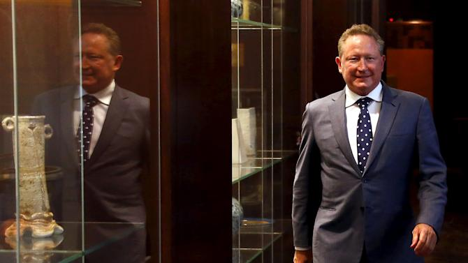 Andrew Forrest, chairman of Fortescue Metals Group, walks to a media conference in Sydney