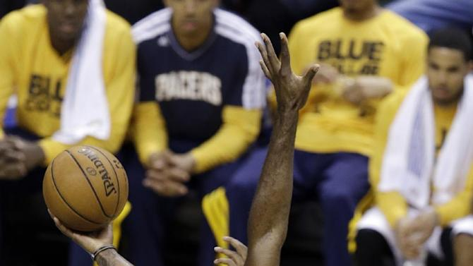 Indiana Pacers' Paul George (24) shoots against Miami Heat's Joel Anthony during the first half of Game 3 of the NBA Eastern Conference basketball finals in Indianapolis, Sunday, May 26, 2013. (AP Photo/Michael Conroy)